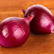 Royalty-Free Stock Photo: Purple onion on wooden background