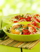 Noodles with vegetables on plates on nature background — Stock Photo