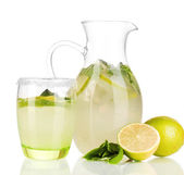 Lemonade in pitcher and glass isolated on white — Stock Photo