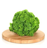 Curve parsley on wooden board isolated on white — Stock Photo