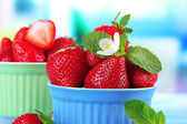 Ripe sweet strawberries in bowls — Stock Photo