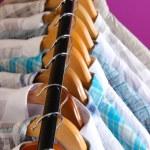 Men's shirts on hangers on purple background — Stock Photo