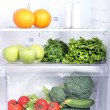 Open refrigerator with vegetarian food — Стоковая фотография