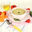 Nourishing soup in pink pon wooden table close-up — Stock Photo #26736841