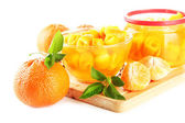 Orange jam with zest and tangerines on wooden desk, isolated on white — Stock Photo