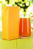 Juice pack on table on bright background — Stock Photo