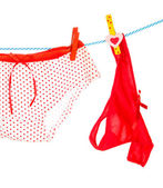 Women's panties hanging on rope isolated on white — Stock Photo