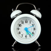 Old style alarm clock isolated on black — Stock Photo
