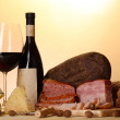 Exquisite still life of wine, cheese and meat products — Stock Photo #26795133