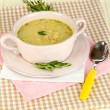 Nourishing soup in pink pon wooden table close-up — Stock Photo #26795207