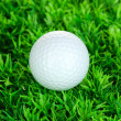 Golf ball on grass close up — Stock Photo