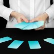 Hand with business cards. Concept: Business like poker game. Isolated on black — Stock Photo #26795809