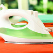Steam iron on bright background — Stock Photo