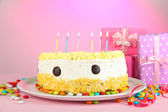 Happy birthday cake and gifts, on pink background — Stock Photo