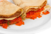 Delicious pancakes with red caviar on plate close-up — Stock Photo