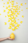 Paper yellow butterflies fly out of vase — Stock Photo