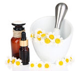 Essential oil and chamomile flowers in mortar isolated on white — Stock Photo