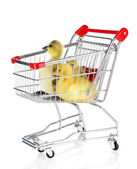 Little ducklings in trolley isolated on white — Stock Photo