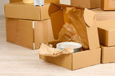 Moving boxes on the floor in empty room — Stock Photo