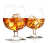 Brandy glasses with ice isolated on white — Stock Photo