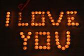 Romantic candles on dark background — Stock Photo