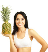 Girl with fresh pineapple isolated on white — Stock Photo