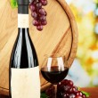Stock Photo: Composition of wine, wooden barrel and grape, on bright background