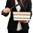 Woman holding wooden gavel and law books isolated on white — Stock Photo #26824819