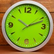 Round office clock on wooden background — Stock Photo