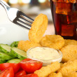 Fried chicken nuggets with vegetables,cola and sauce isolated on white — Stock Photo