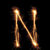 "Letter ""N"" sparklers on black background — Stock Photo"