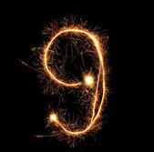 "Number ""nine"" sparklers on black background — Stock Photo"