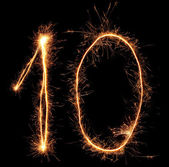 "Number ""ten"" sparklers on black background — Stock Photo"