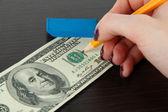 Haciendo dólar falso sobre fondo de madera — Foto de Stock