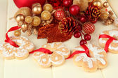 Christmas cookies and decorations on color wooden background — Stok fotoğraf