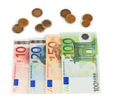 Euro banknotes and euro cents isolated on white — Stockfoto