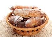 Taste croissants in basket isolated on whit — Stock Photo