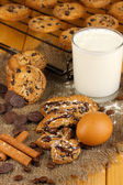 Chocolate cookies on the baking with glass of milk close up — Stock Photo