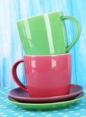 Two cups on blue background — Stock Photo