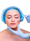 Young woman receiving plastic surgery injection on her face close up — Foto de Stock