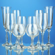 Collection of wine glasses, on blue background — Stock Photo