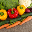 Fresh vegetables on burlap background — Stock Photo #26904935