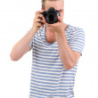 Handsome photographer with camera, isolated on white — Stock Photo #26905055