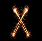 "Letter ""X"" sparklers on black background — Stock Photo"