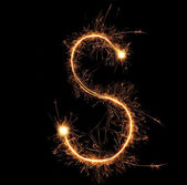 "Letter ""S"" sparklers on black background — Stock Photo"