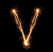 "Letter ""V"" sparklers on black background — Stock Photo"