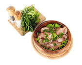 Chicken meat in wooden bowl, herbs, spices isolated on white — Stock Photo