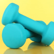 Stock Photo: Dumbbells on yellow background