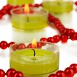 Lighted candles with beads close up — Stock Photo #26939667