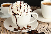 Cup of whipped cream coffee on wooden table close up — Stock Photo